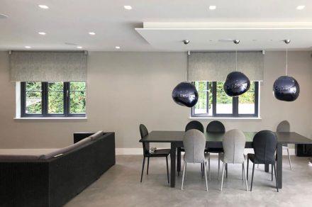 Roller blinds in modern, designer house