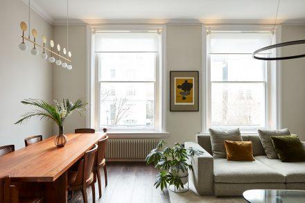 White roller blinds in designer home